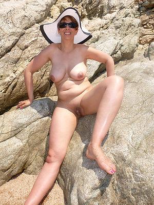 whorish full-grown women atop beach pics