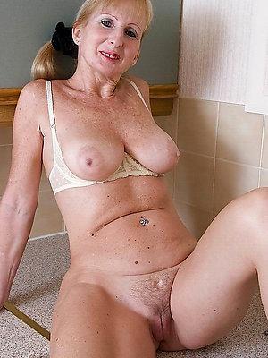 mature blonde big tits posing nude