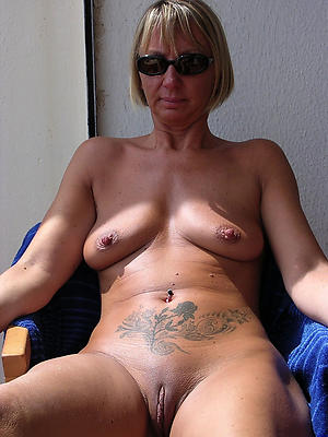 tattooed mature women stripped nude
