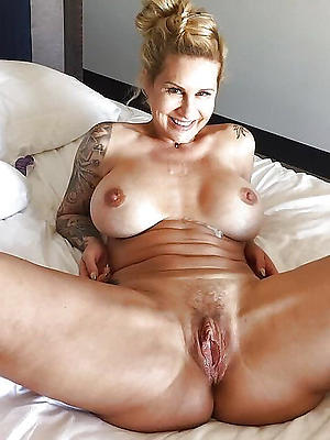 nasty tattooed mature porn photos