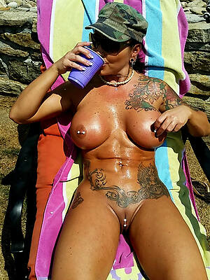 busty mature women with tattoos porn