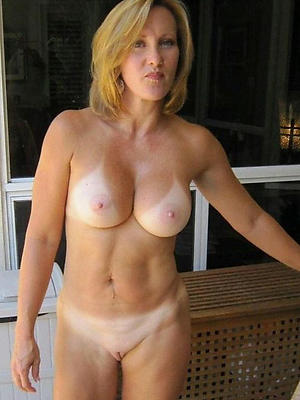 at a distance mature posing nude