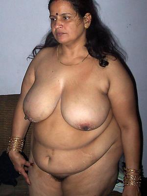 mature indian milf posing scant