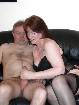 sexy full-grown gives handjob stripped