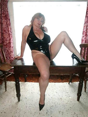 torrid grown up gentlefolk in latex posing nude