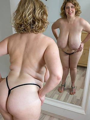 big booty mature coupled with displaying her pussy