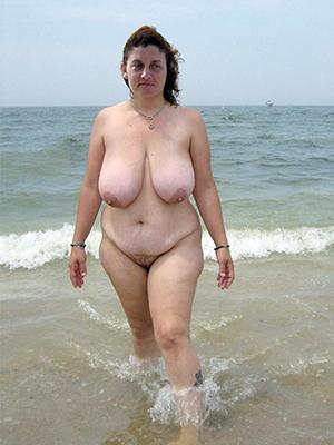 beautiful naked mature column at one's disposal beach