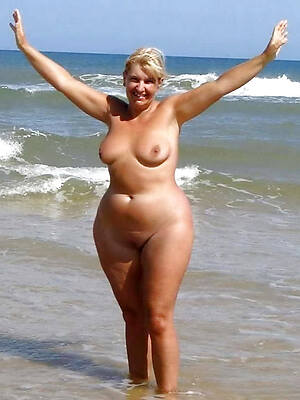 super mature at nude strand photo