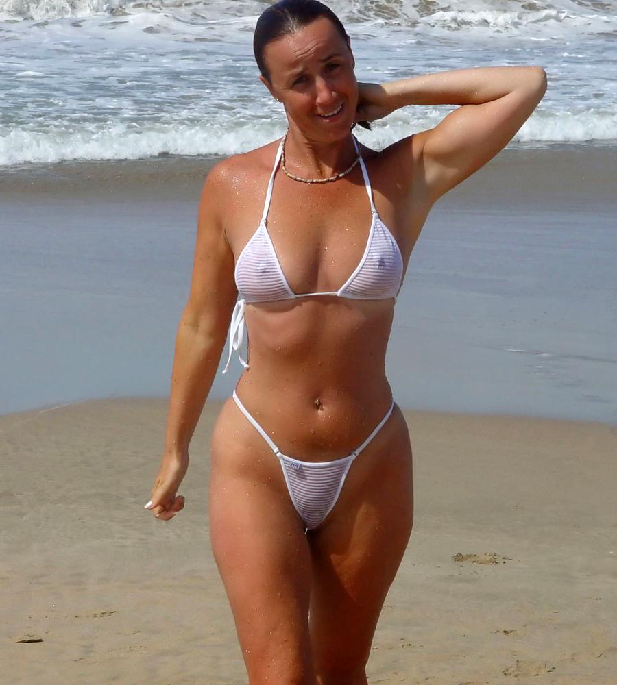 Redhead in crotchless bikini