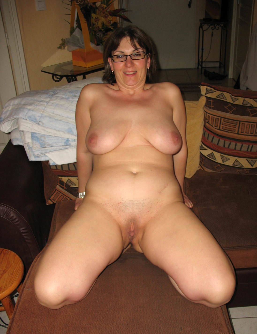 Woman with large breasts being topless